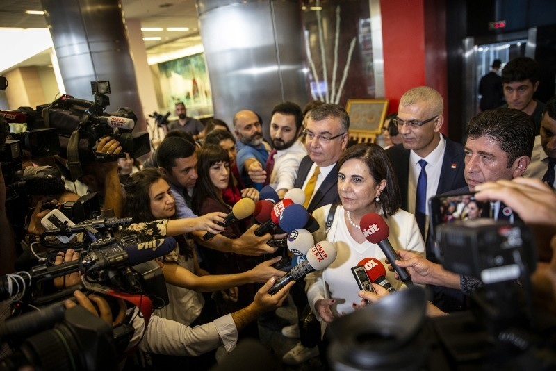 Gaye Usluer, a member of the CHP Party Assembly, answers reporters' questions outside the party's headquarters in Ankara. (AA Photo)