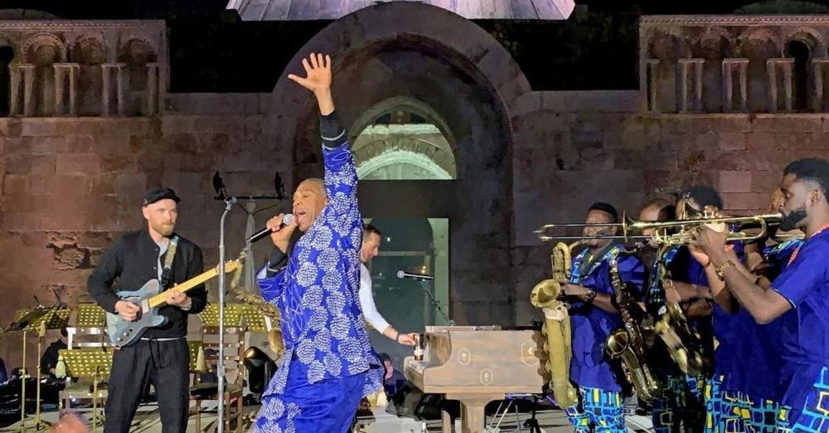 Nigerian musician Femi Kuti (middle) performs with British band Coldplay at the Citadel in Amman, Jordan, Nov. 23, 2019. (EPA)