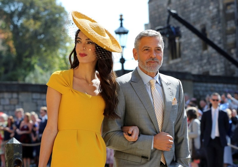 Amal Clooney and George Clooney arrive at St George's Chapel at Windsor Castle for the wedding of Meghan Markle and Prince Harry.  Saturday May 19, 2018