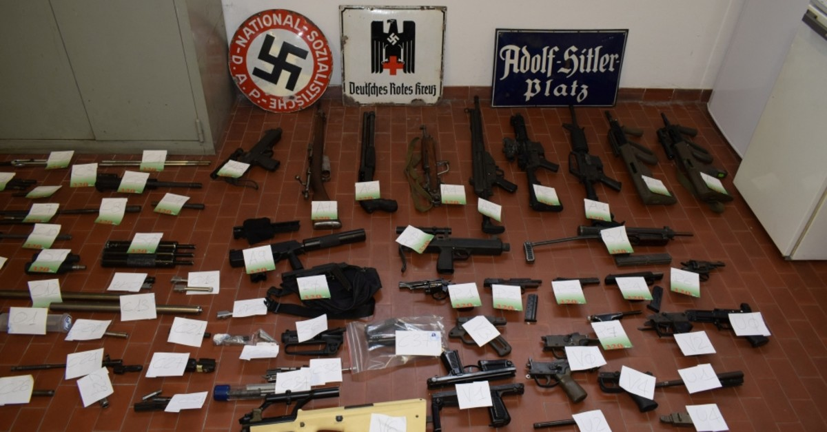 An Italian police display shows a large arsenal of weapons seized in raids on neo-Nazi sympathizers, Turin, July 15, 2019.