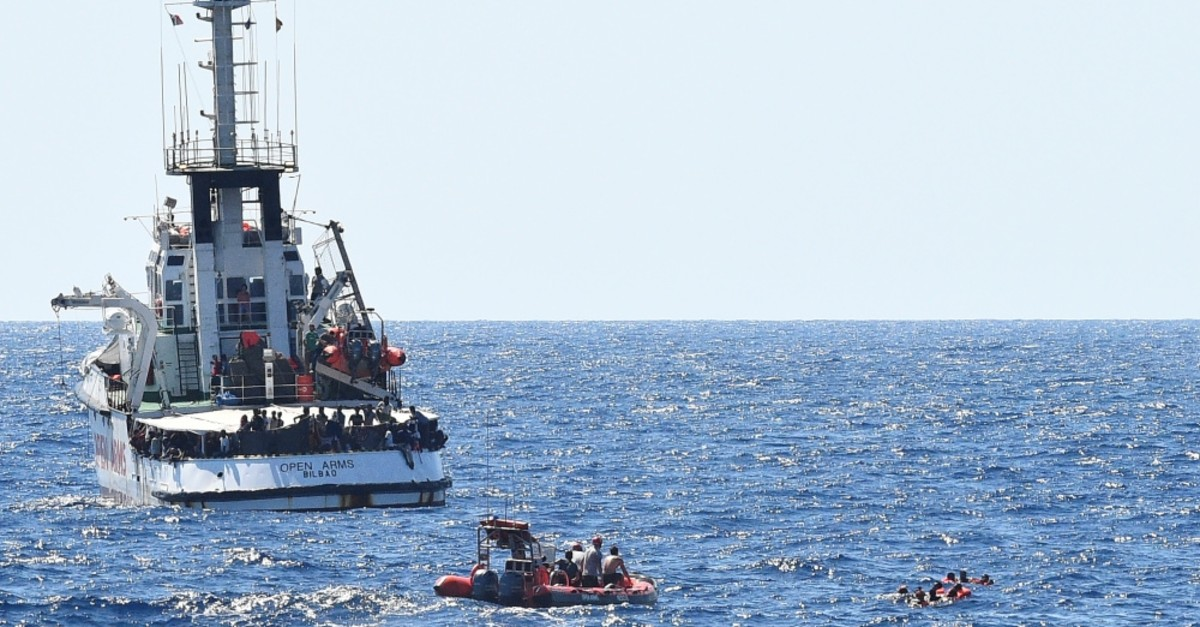 Migrants try to swim to shore after jumping off the Spanish rescue ship Open Arms, Lampedusa, Aug. 20, 2019.