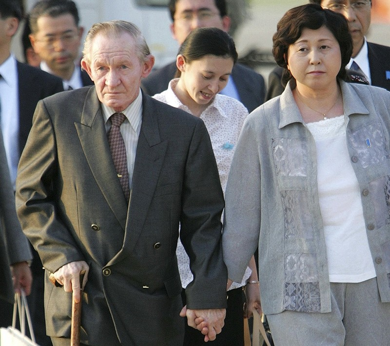 In this July 18, 2004 file photo, former U.S. Army deserter to North Korea, Charles Jenkins, left, escorted by his wife Hitomi Soga, right, and their daughter Mika, center, arrives at Tokyo's Haneda International Airport. (AP Photo)