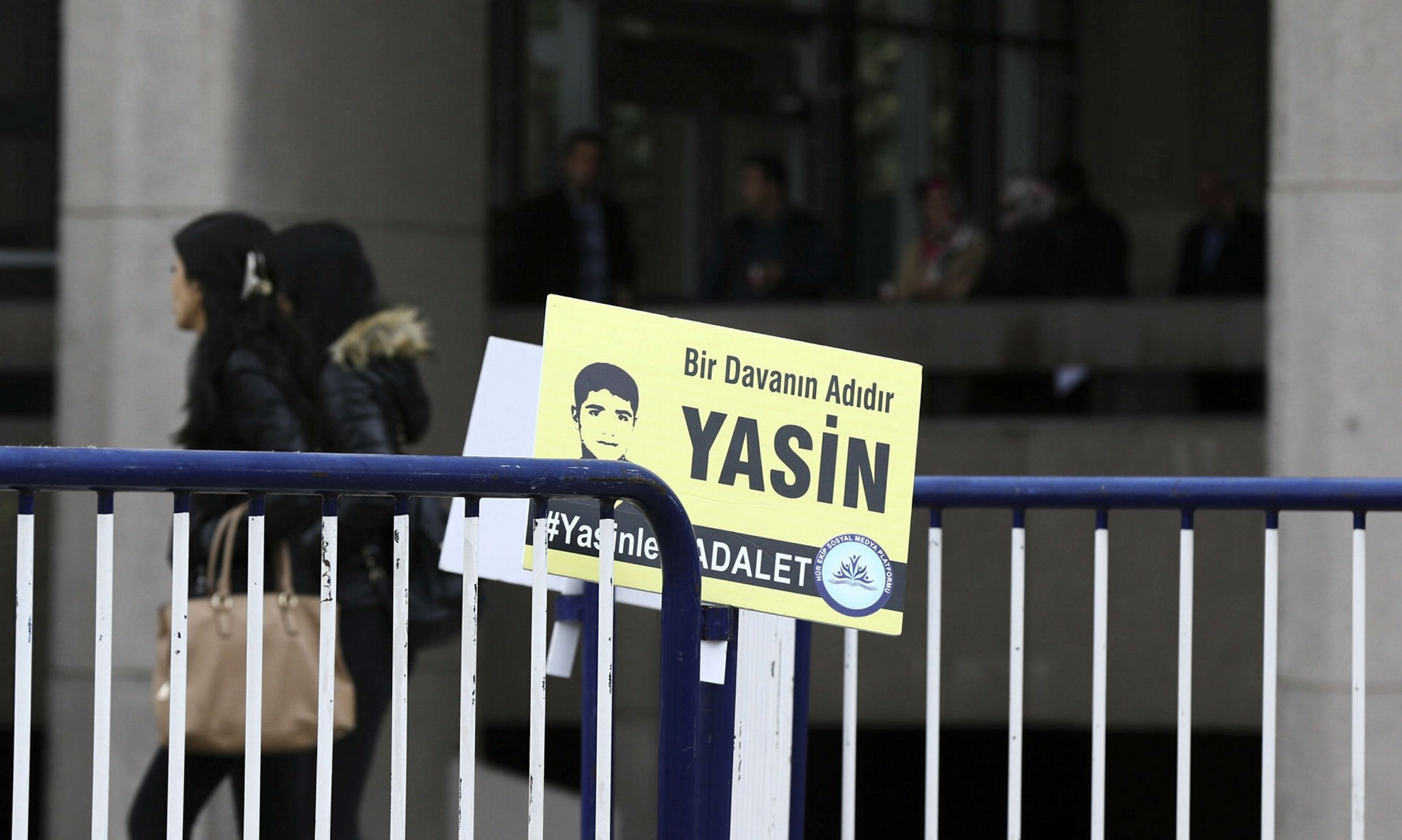 A placard reading ,Yasin Bu00f6ru00fc is the name for a cause - #JusticeForYasin, is left near the Ankara court where the trial is held (AA Photo)
