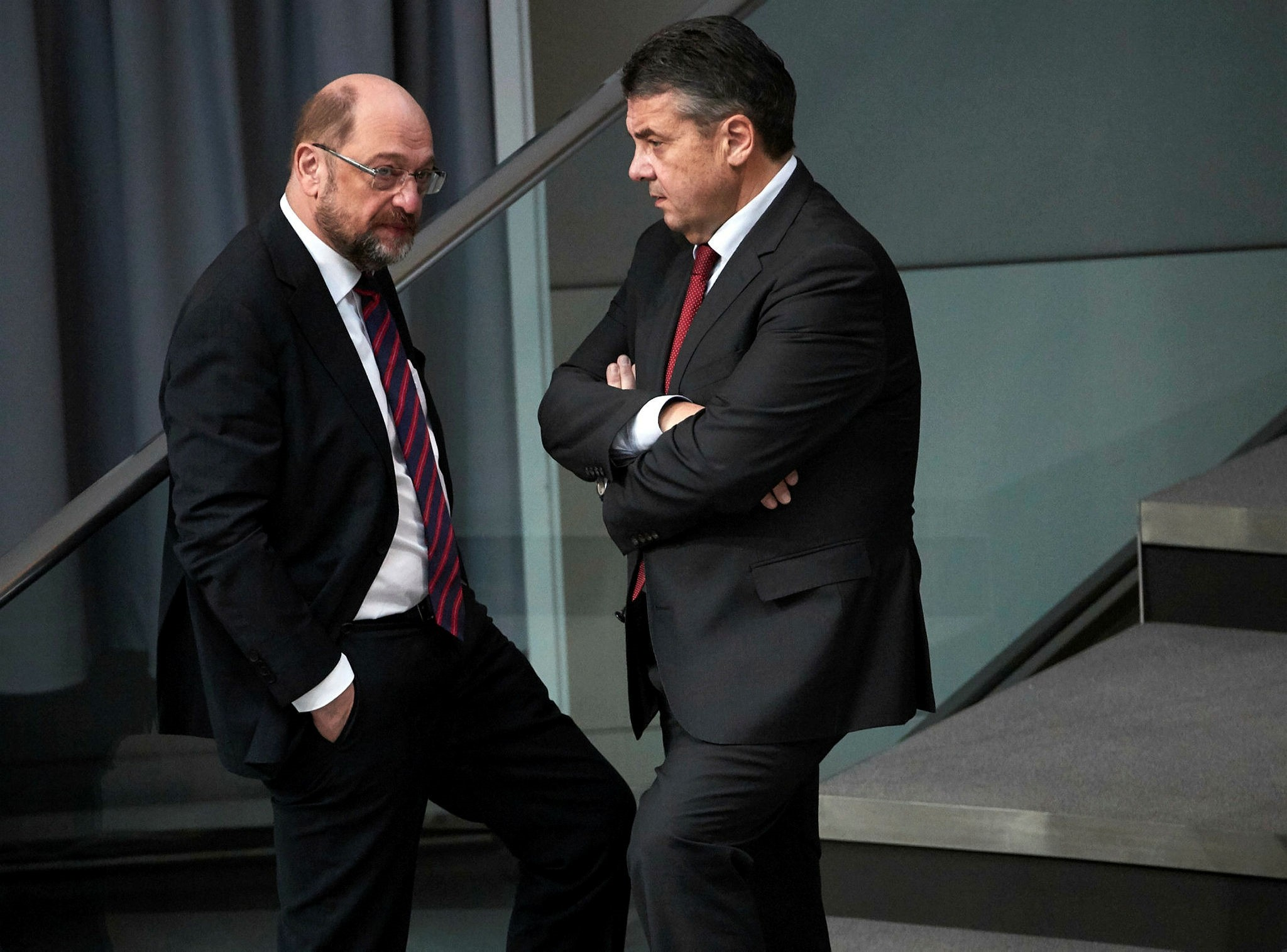 German Foreign Minister Sigmar Gabriel (R) and the leader of the Social Democratic Party (SPD) Martin Schulz (L) speak during a session of German parliament, Berlin, Feb. 1.