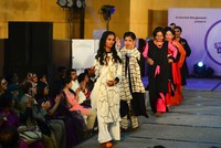 Survivors of acid attacks strutted down the catwalk at a fashion show in Dhaka Tuesday in an effort to stamp out prejudice against victims of these brutal assaults.