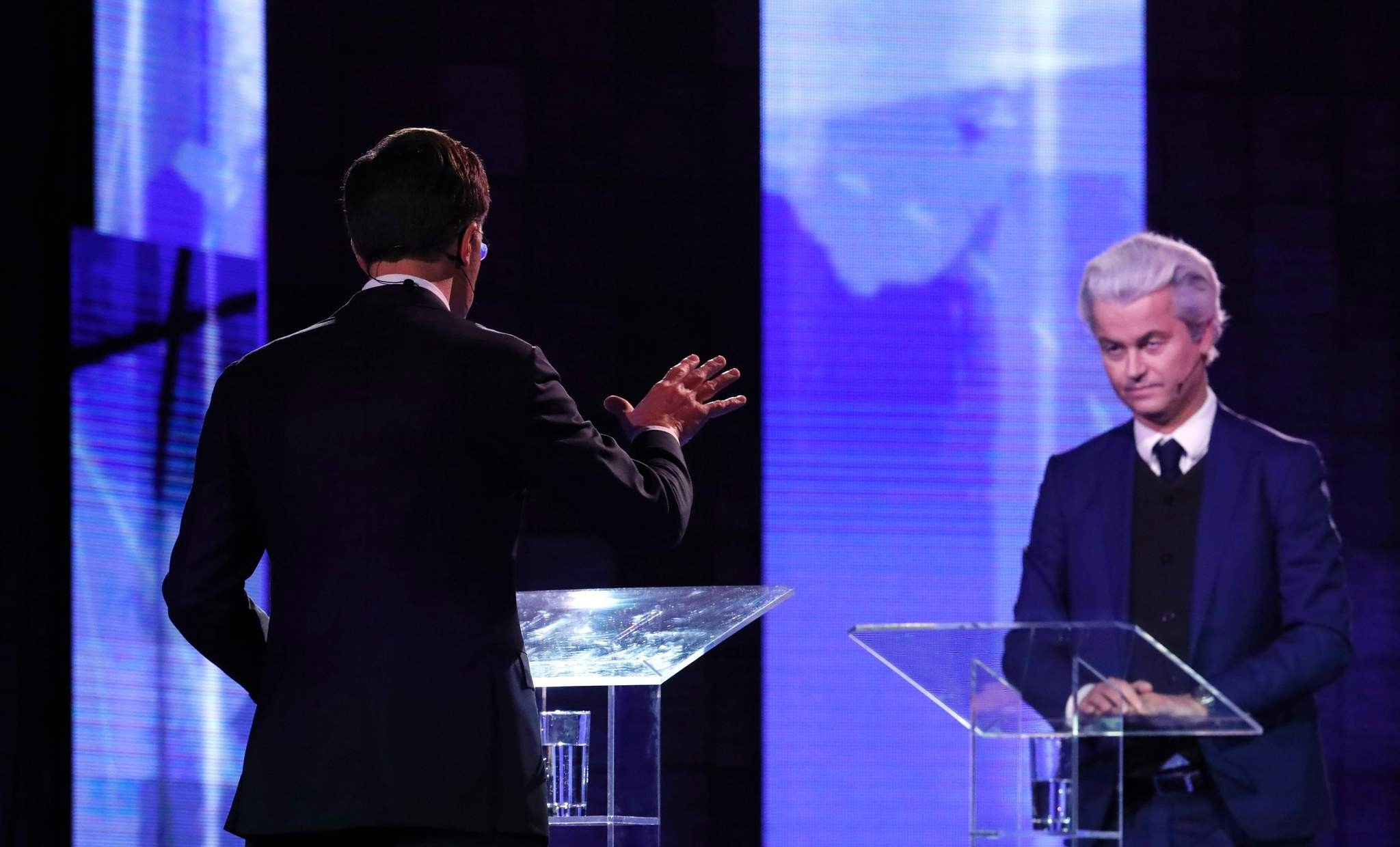 Dutch Prime Minister Mark Rutte (L) gestures while debating with the Netherlands' far-right politician Geert Wilders in Rotterdam on March 13, prior to the Dutch parliamentary elections held on March 15.