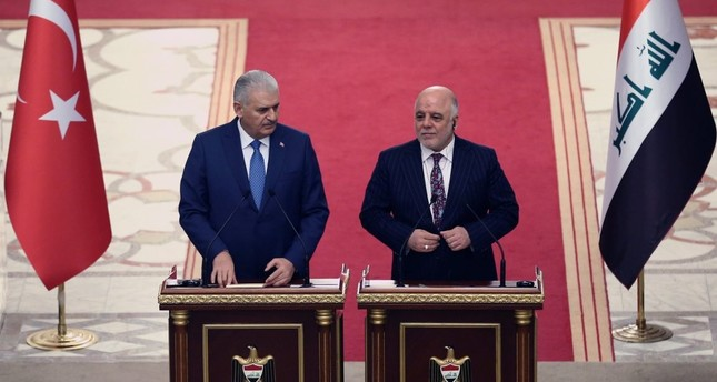 Prime Minister Yıldırım (L) has confirmed that an invitation has been sent by Iraqi Prime Minister Abadi, shown here at a joint press conference in Baghdad, Jan. 7.