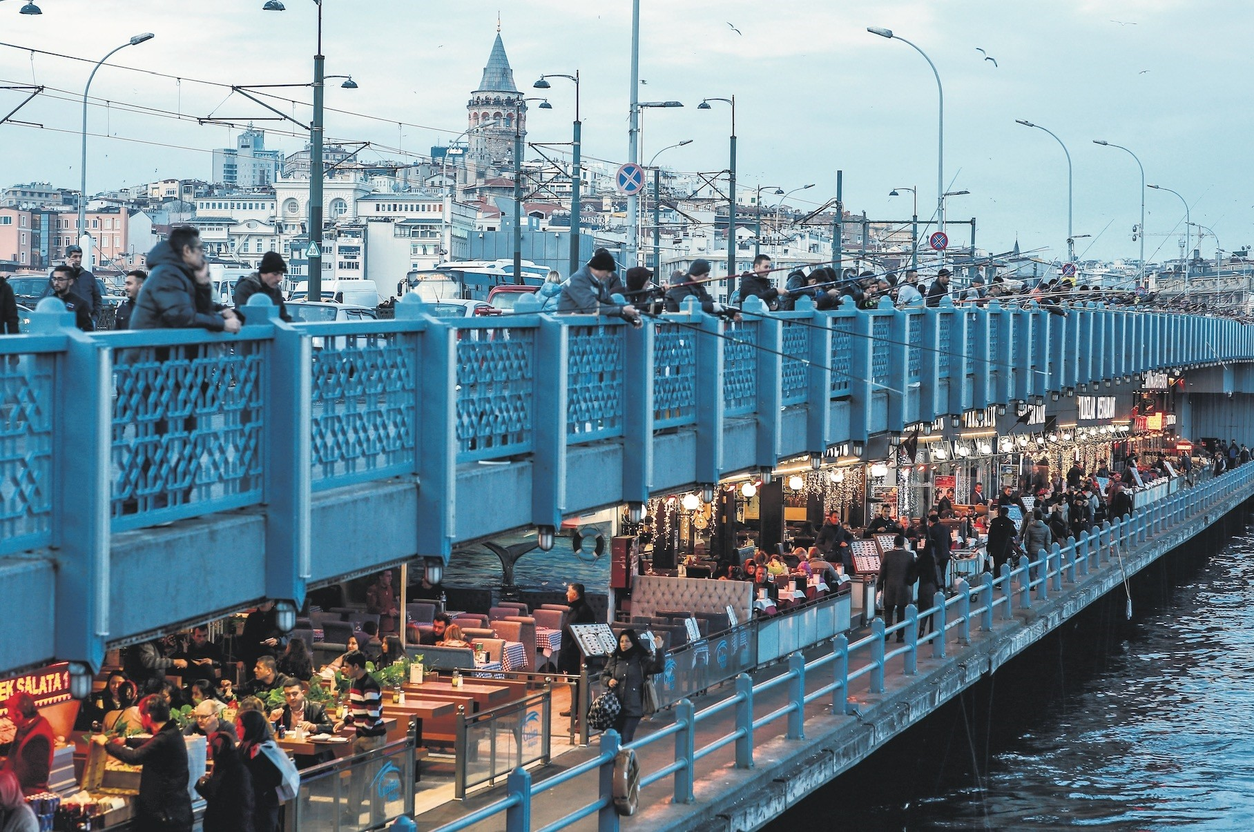 People on the Galata Bridge over Istanbulu2019s Golden Horn. The city is the most crowded place in Turkey and has a population of over 14 million people.