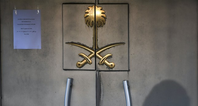 The shadow of a security member is seen on the door of the Saudi Arabian Consulate in Istanbul, Oct. 29, 2018, while the investigation into the murder of Saudi journalist Jamal Khashoggi is underway.