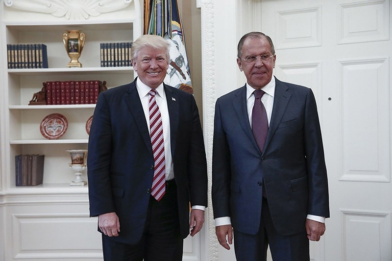 US President Donald J. Trump (L) posing with Russian Foreign Minister Sergei Lavrov (R) during their meeting at the White House in Washington, DC on May 10, 2017. AFP Photo.