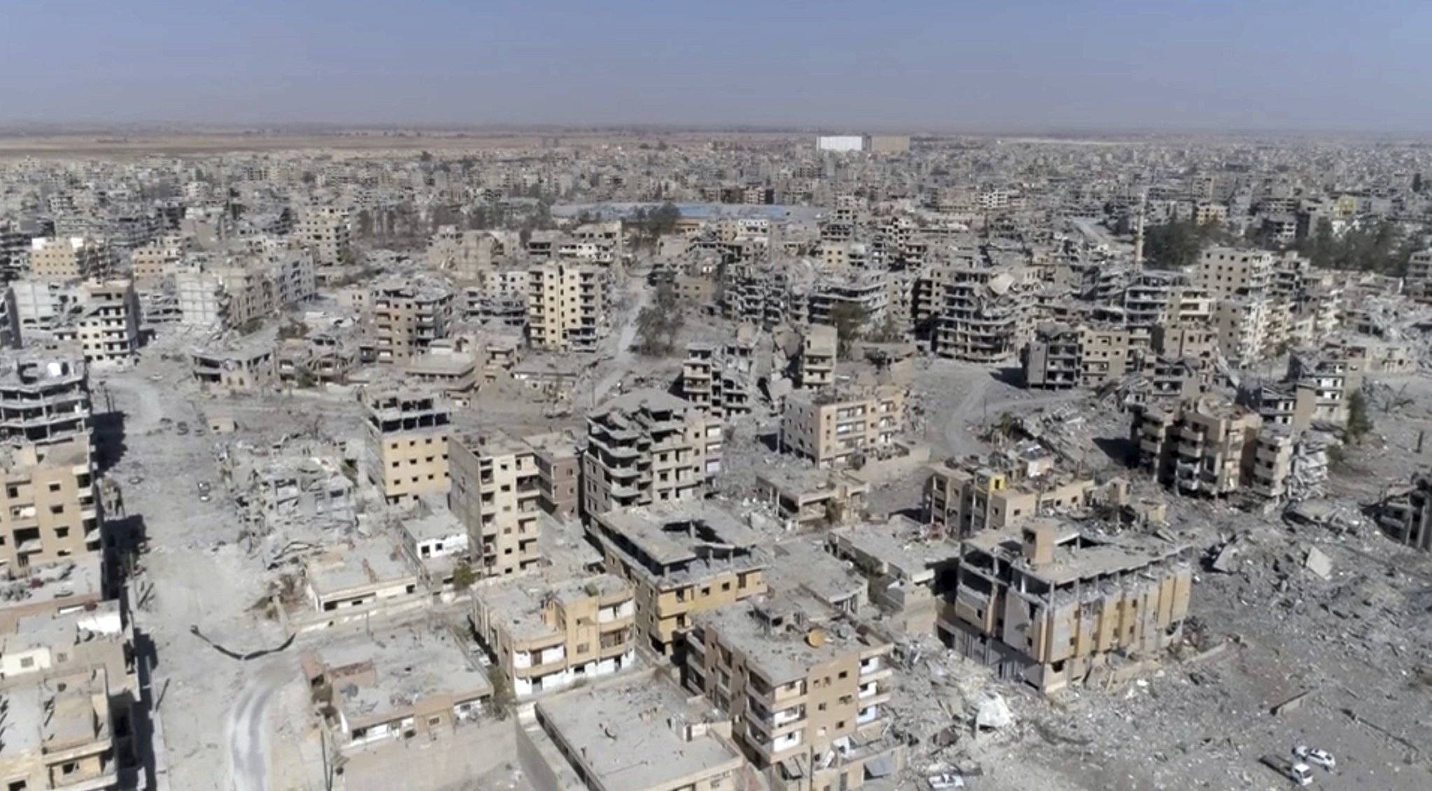 This Thursday, Oct. 19, 2017 frame grab made from drone video shows damaged buildings in Raqqa, Syria. (AP Photo)