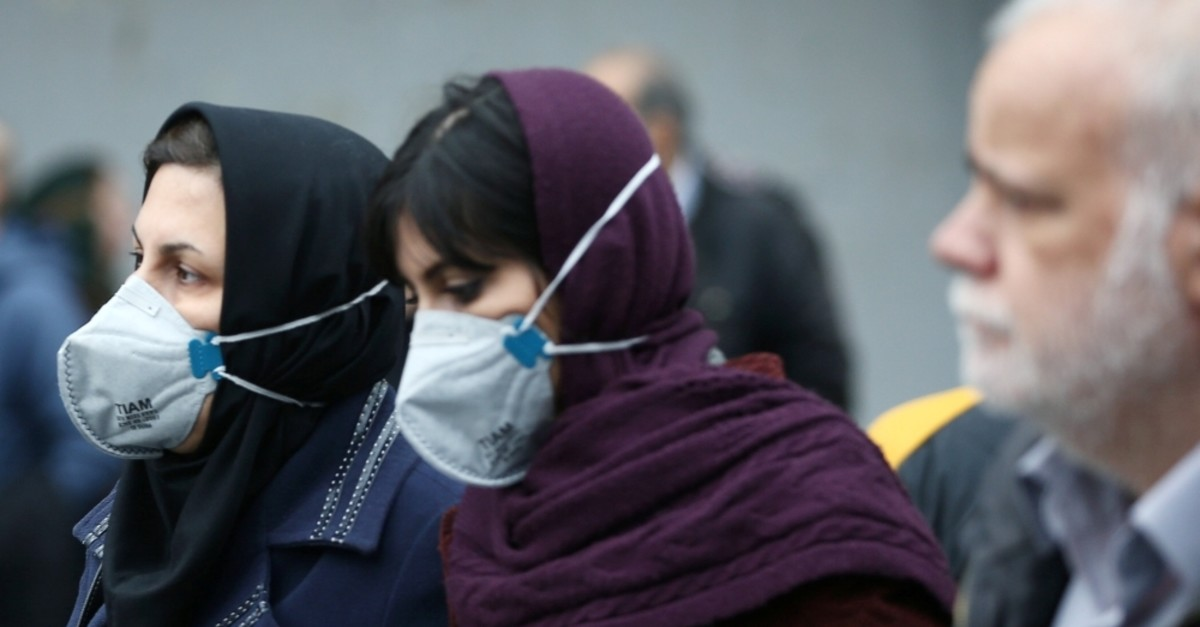 Iranian women wear protective masks to prevent contracting the coronavirus as they walk at the Grand Bazaar, Tehran, Feb. 20, 2020. (Reuters Photo)