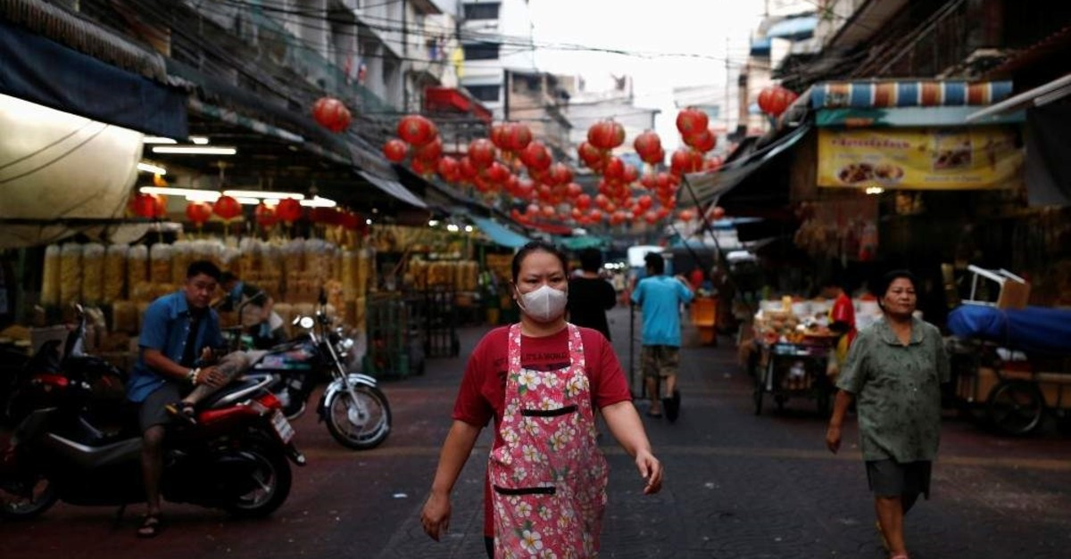 A woman wears a mask to prevent the spread of the new coronavirus as she walks in Chinatown at Bangkok, Thailand February 2, 2020. (Reuters Photo)