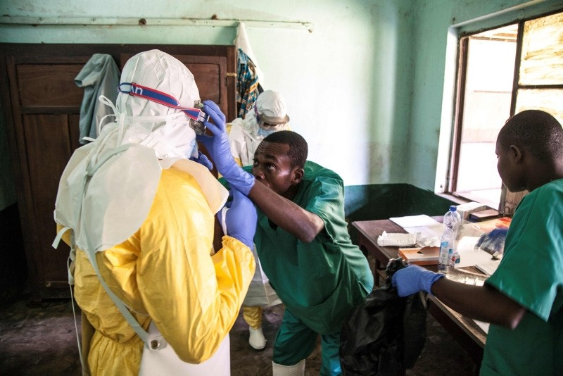 In this handout photograph released by UNICEF on May 13, 2018, health workers wear protective equipment as they prepare to attend to suspected Ebola patients at Bikoro Hospital. (AFP Photo)