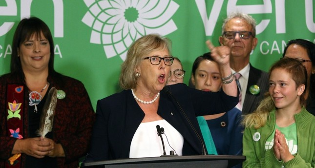 Green Party leader Elizabeth May announces the official launch of the Green Party of Canada election campaign as she's joined by green candidates during a news conference (AP Photo)