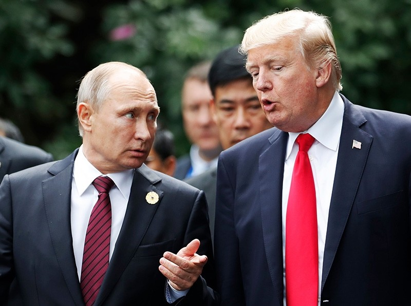 In this file photo taken on November 11, 2017 US President Donald Trump (R) and Russia's President Vladimir Putin talk as they make their way to take the ,family photo, during the APEC leaders' summit in the Vietnamese city of Danang. (AFP Photo)