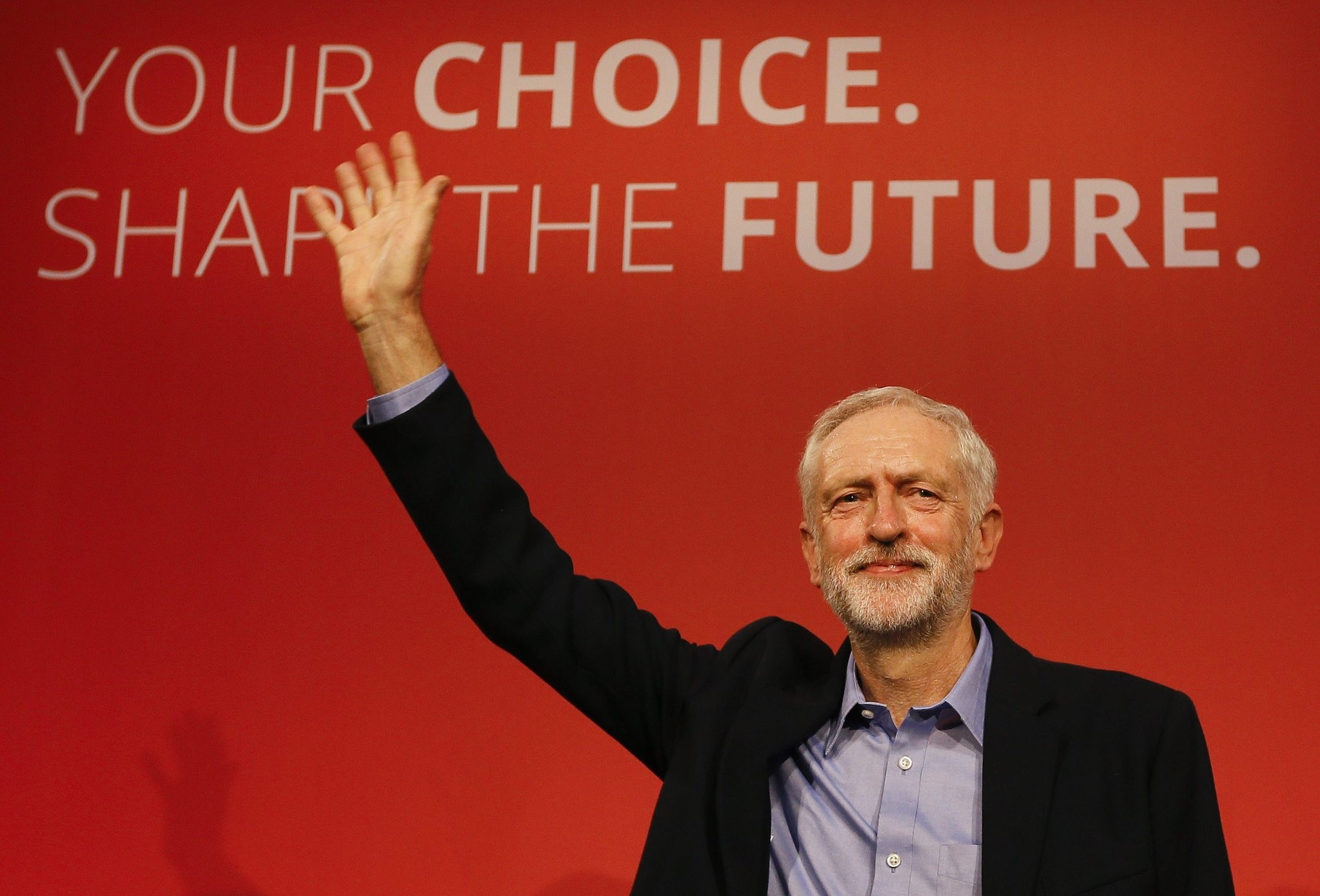 Jeremy Corbyn waves to supporters after he is announced as the new leader of the Labour Party during the partyu2019s leadership conference, London, Sept. 12, 2015.