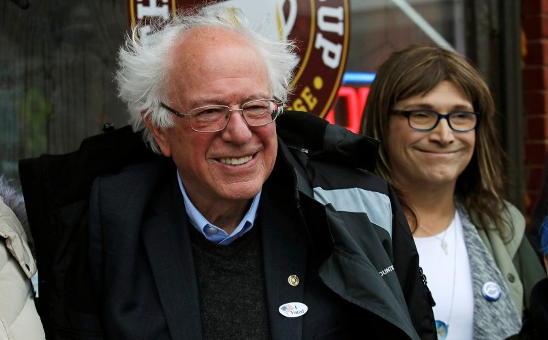 U.S. Sen. Bernie Sanders, I-Vt., left, smiles as he poses for a photograph with Vermont Democratic gubernatorial candidate Christine Hallquist, right, outside city hall in Saint Albans, Vt., Tuesday, Nov. 6, 2018. (AP Photo)