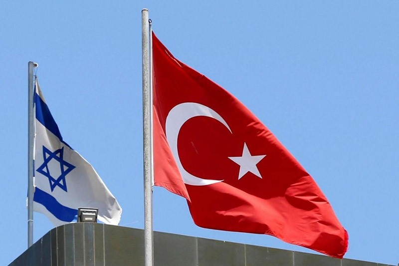 A Turkish flag flutters atop the Turkish embassy as an Israeli flag is seen nearby, in Tel Aviv, Israel June 26, 2016. (Reuters Photo)