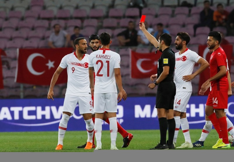 Turkey's Cenk Tosun is shown a red card by the referee. (REUTERS Photo)