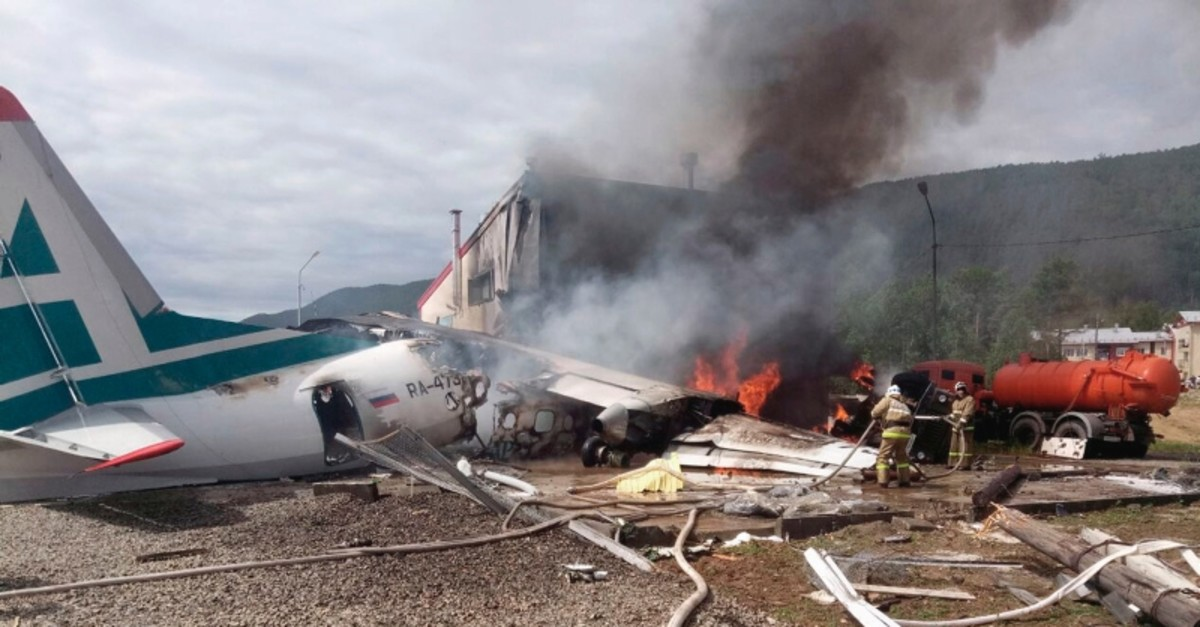 Emergency services attend the crash scene of an An-24 plane of Angara Airlines in Nizhneangarsk, Republic of Buryatia, Russia, Thursday, June 27, 2019. (AP Photo)