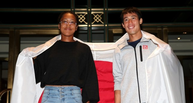 Men's singles semifinalist Kei Nishikori of Japan and women's singles semi-finalist Naomi Osaka of Japan pose for a portrait outside The Kitano Hotel following their quarterfinal matches on day 10 of the 2018 US Open at Kitano Hotel on Sept. 5, NYC.