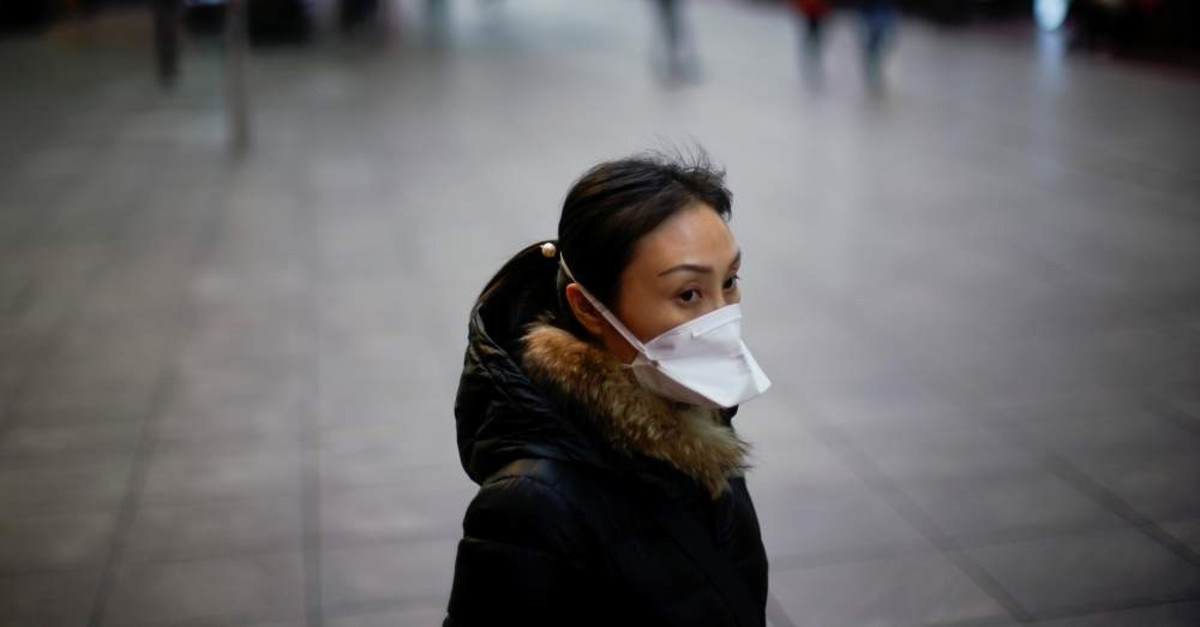 A woman wears a mask at a main shopping area as the country is hit by an outbreak of the new coronavirus in downtown Shanghai, China February 21, 2020. (Reuters Photo)