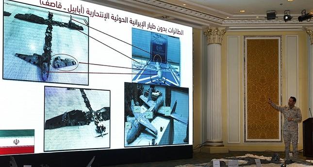 الناطق الرسمي باسم التحالف العربي يعرض صور طائرات مسيرة أسقطت فوق السعودية خلال الأيام الماضية (EPA)