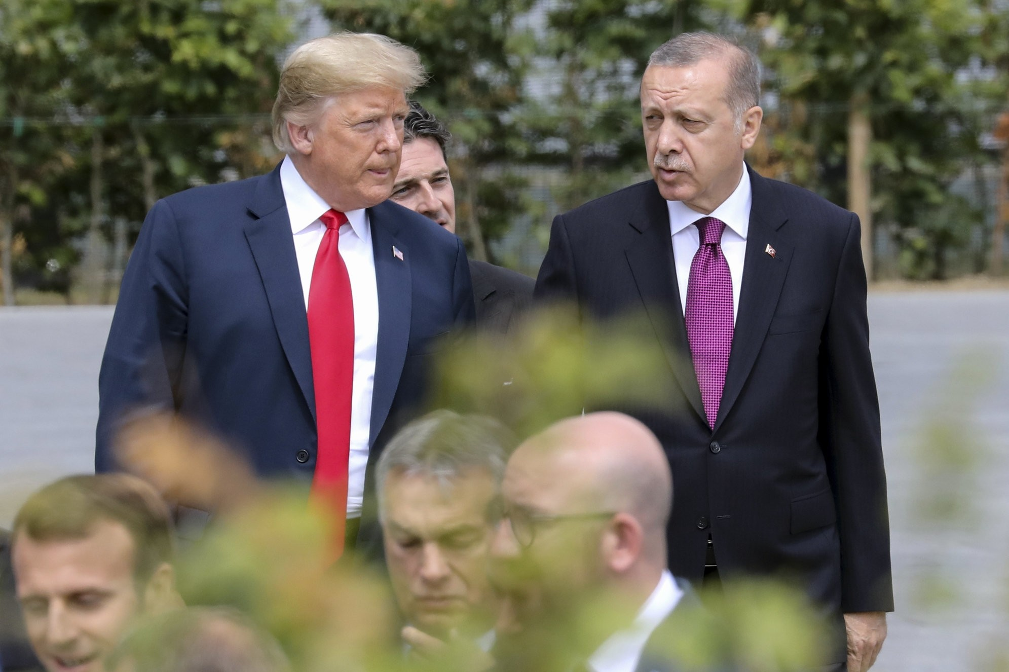 U.S. President Trump (L) and President Erdou011fan speak ahead of the opening ceremony of the NATO meeting, Brussels, July 11.