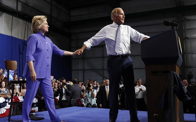 Vice President Joe Biden takes Democratic presidential candidate Hillary Clinton's hand as he speaks at a campaign event at Riverfront Sports in Scranton, Pa., Monday, Aug. 15, 2016. (AP Photo)