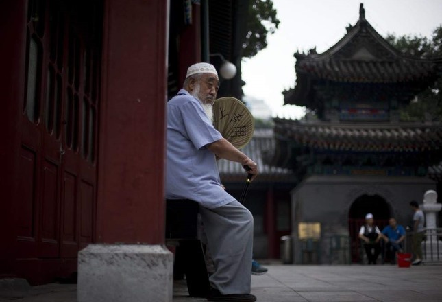 A Chinese Muslim man waits for the time to break his fast during the Muslim holy month of Ramadan at the Niujie mosque, the oldest and largest mosque in Beijing, China, July 2, 2014. AP Photo