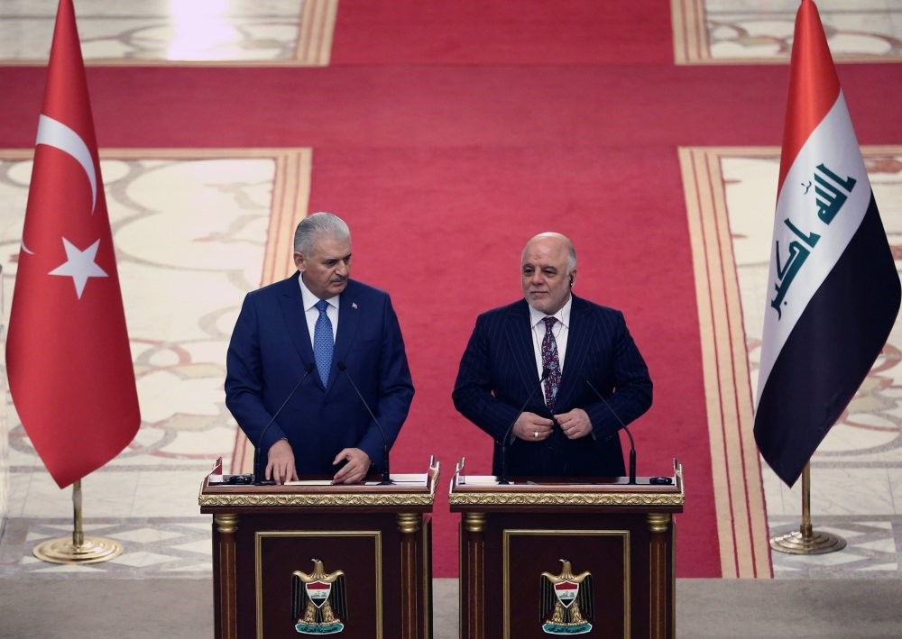 Prime Minister Yu0131ldu0131ru0131m (L) has confirmed that an invitation has been sent by Iraqi Prime Minister Abadi, shown here at a joint press conference in Baghdad, Jan. 7.