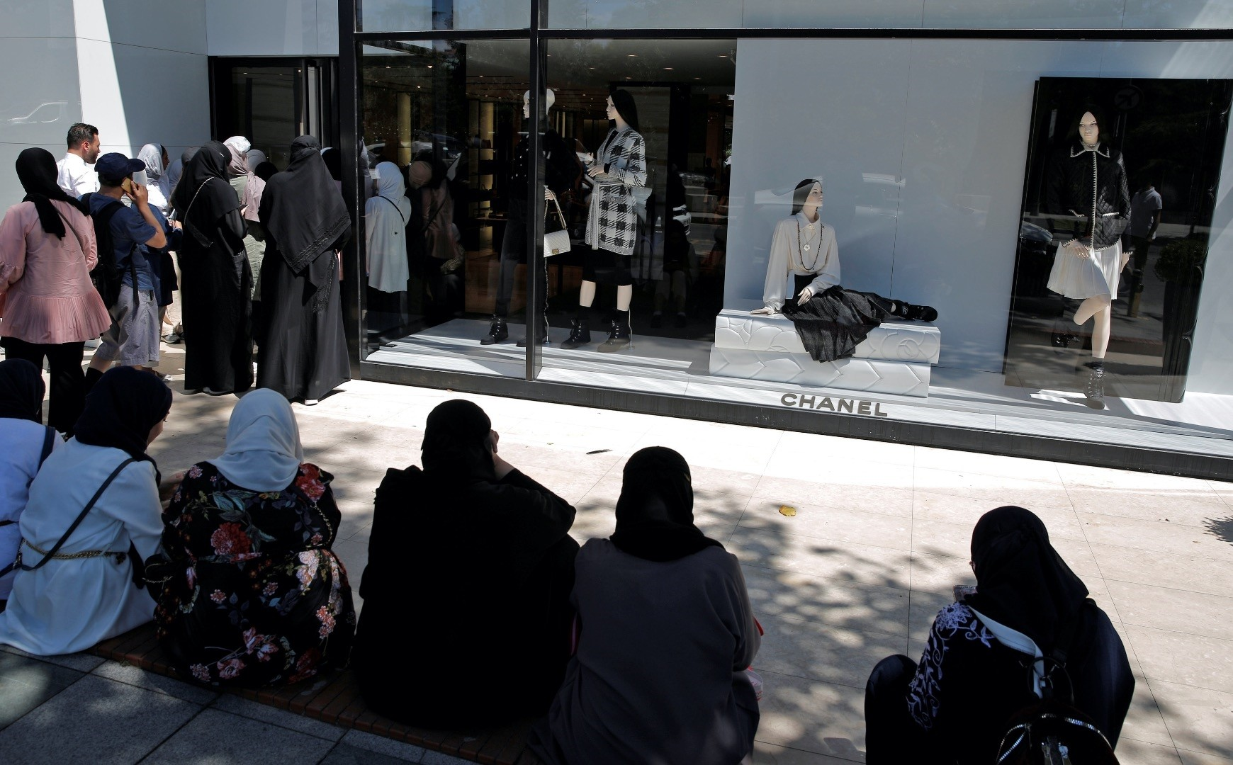 Tourists wait to enter a Chanel store in Istanbul.