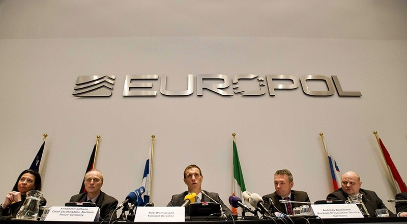 Director of Europol, Rob Wainwright (C) speaks during a press conference in The Hague, The Netherlands, 04 February 2013 (EPA File Photo)