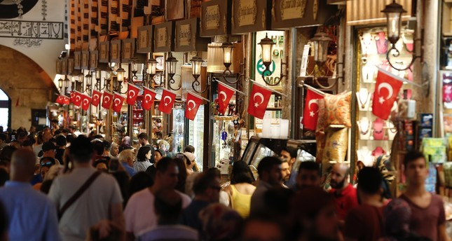 Tourists walk in a historical covered bazaar in Istanbul on Aug. 20, the first day of the nine-day Qurban Bayram (Eid al-Adha) holiday, which ended Sunday. The holiday saw a great increase in the number of local and foreign tourists.