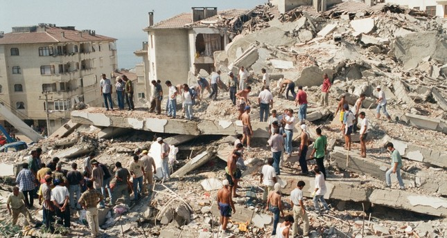 People search for survivors in a collapsed building in Çınarcık, Yalova, Aug. 18, 1999.