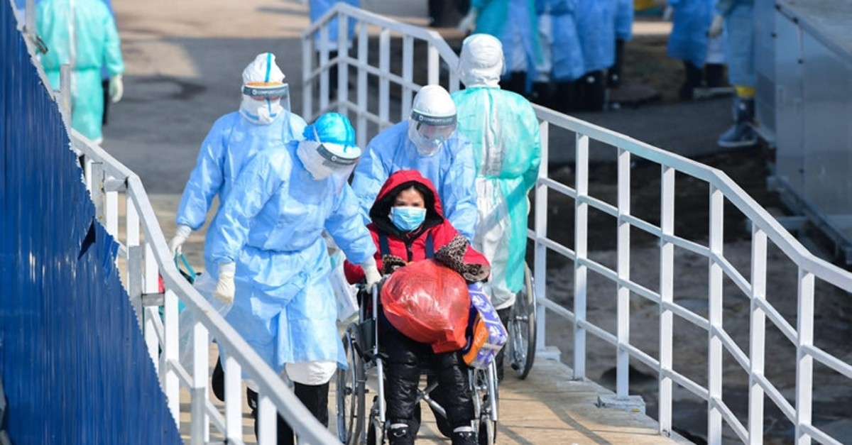 Medical staff transfer patients to the newly completed Huoshenshan temporary field Hospital in Wuhan, Hubei Province, China 04 February 2020. (EPA Photo)