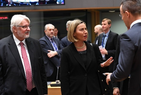 Polish Foreign Minister Witold Waszczykowski (L) and EU foreign policy chief Federica Mogherini (C) arrive to take part in an EU foreign affairs council at the European Council, Brussels, Dec. 11.