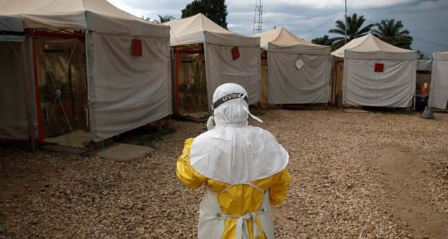 A health worker wearing Ebola protection gear enters the Biosecure Emergency Care Unit CUBE at The Alliance for International Medical Action Ebola treatment center in Beni, in Democratic Republic of Congo, March 30, 2019. Reuters