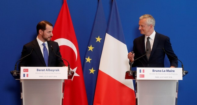 Treasury and Finance Minister Berat Albayrak (L) and his French counterpart Bruno Le Maire and Turkish attend a joint news conference after a meeting at the Bercy Finance Ministry in Paris, France, August 27, 2018. (Reuters Photo)