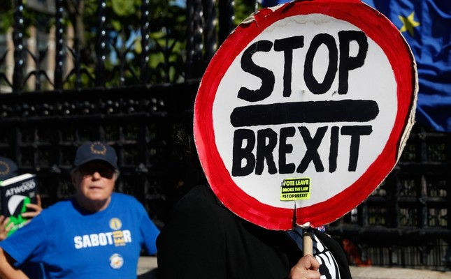 Ani-Brexit protesters demonstrate outside the Houses of Parliament in London, Thursday, Sept. 12, 2019. AP Photo