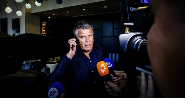 Emile Ratelband, 69, speaks with the press in Amsterdam, The Netherlands, December 3, 2018, after the court's ruling in his case. (EPA Photo)