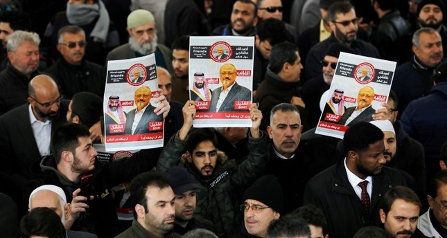 This file photo shows people holding pictures of Saudi journalist Jamal Khashoggi attend a symbolic funeral prayer for Khashoggi at the courtyard of Fatih Mosque in Istanbul, Turkey Nov. 16, 2018. (Reuters Photo)