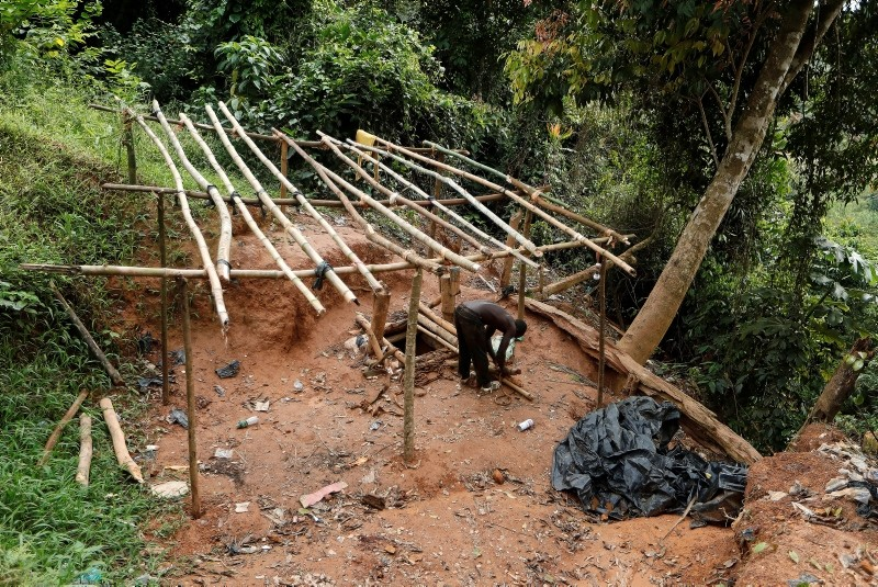 An artisanal gold miner works at the unlicensed mining site of Nsuaem Top in Ghana, November 24, 2018.