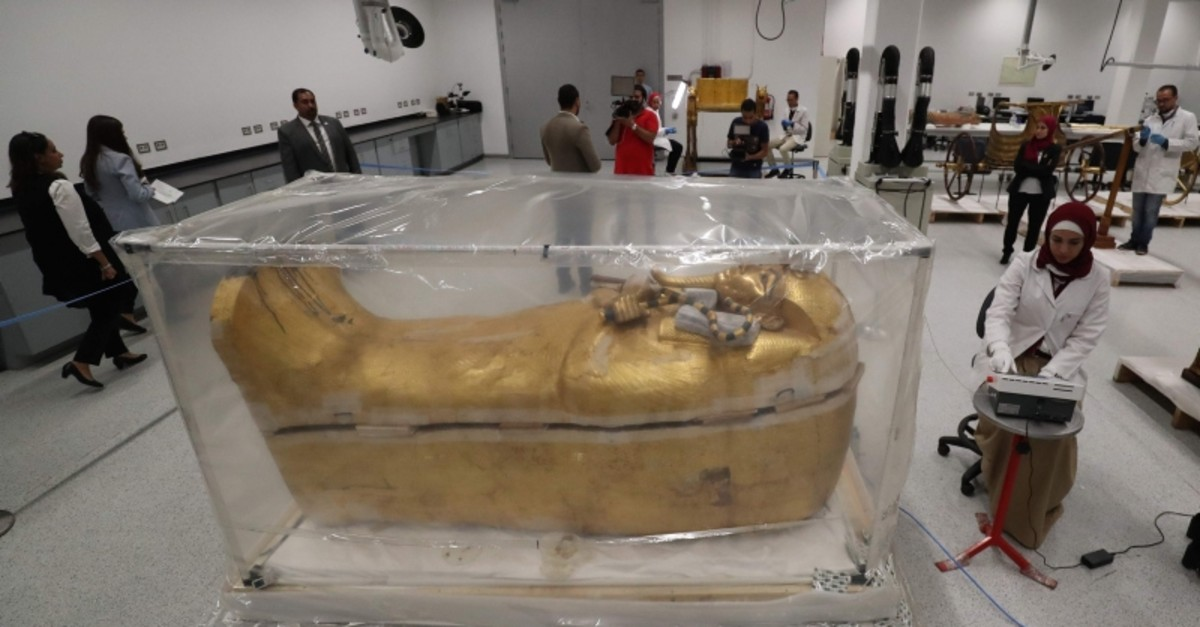 The gold-covered sarcophagus of King Tutankhamun's coffin is encased in a tent for restoration procedures at the conservation center of the the Grand Egyptian Museum in Giza, near Cairo, Egypt, Sunday, Aug. 4, 2019. (AP Photo)