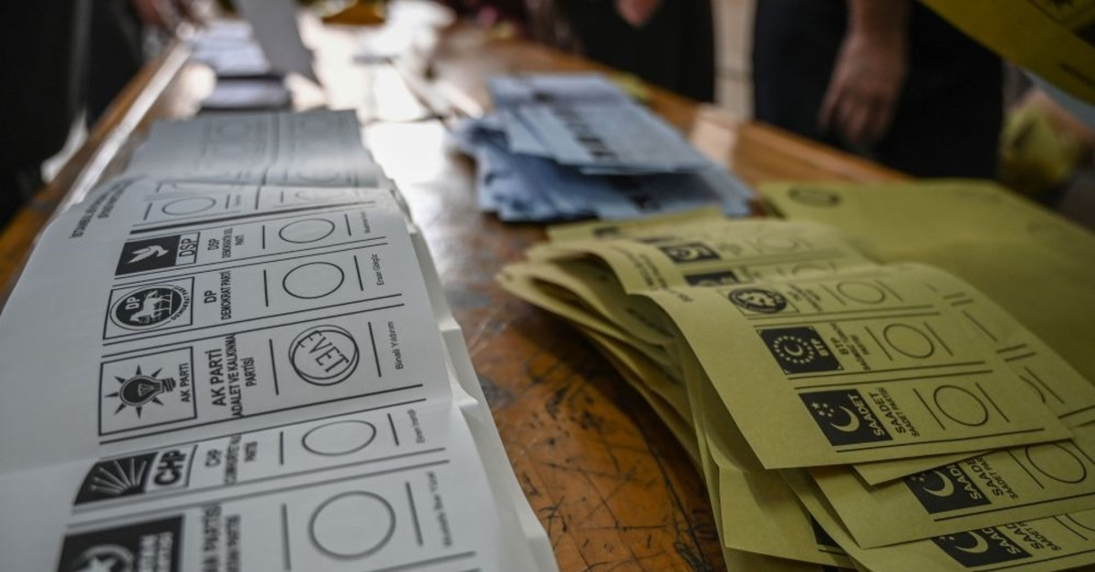 Electoral officers prepare ballots to count at a polling station in Istanbul on March 31, 2019.