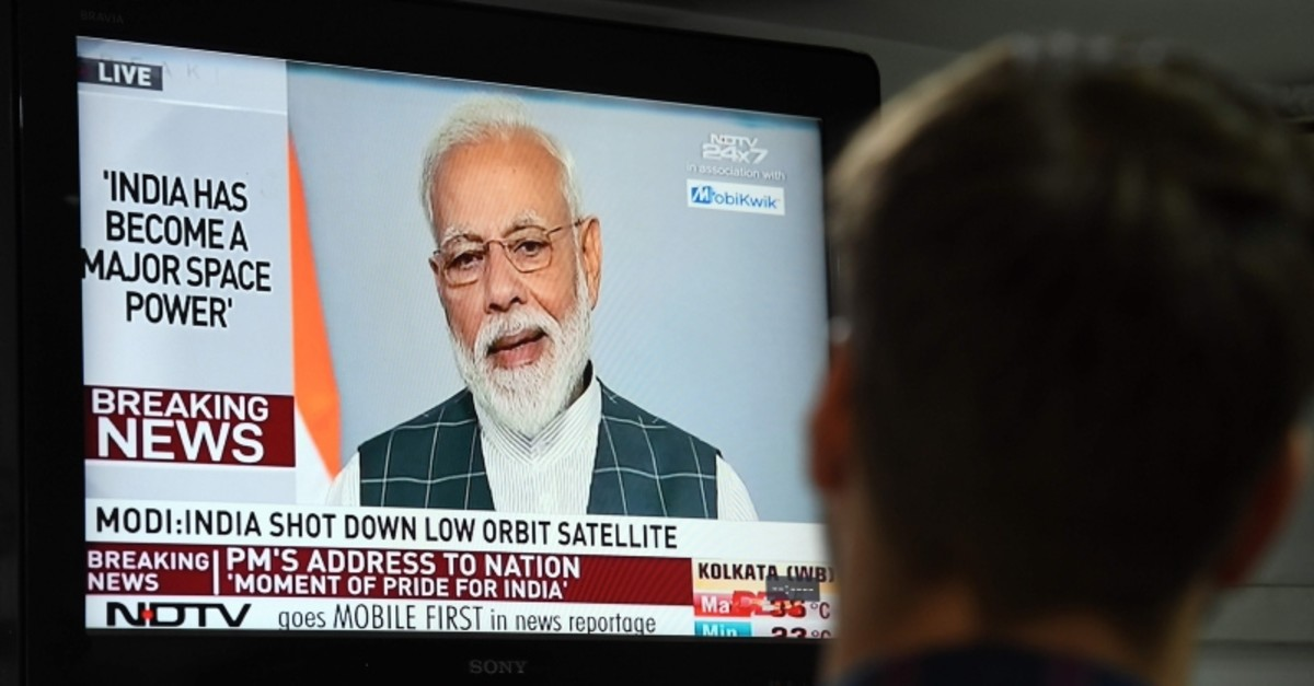 A man watches Indian Prime Minister Narendra Modi's address to the nation on a local news channel in New Delhi, India, March 27, 2019. (AFP Photo)