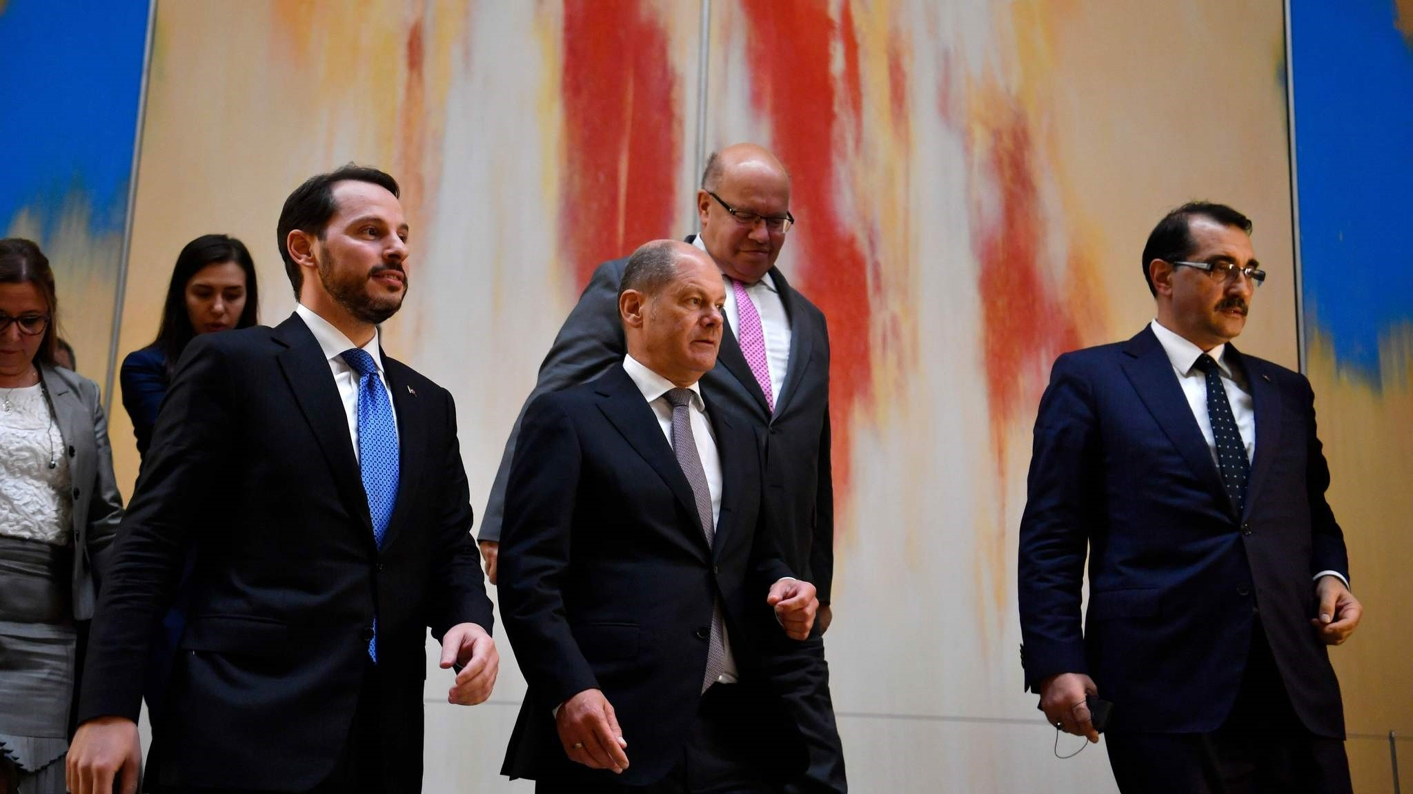 Treasury and Finance Minister Berat Albayrak (L), German Finance Minister Olaf Scholz (C) and German Economy Minister Peter Altmaier (R) arrive to give a joint press statement following their meeting, Berlin, Sept. 21.