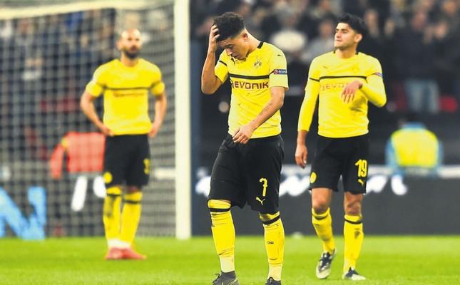 Dortmund's Jadon Sancho (L) and Mahmoud Dahoud react after conceding their second goal to Tottenham Hotspur, Feb. 13, 2019.
