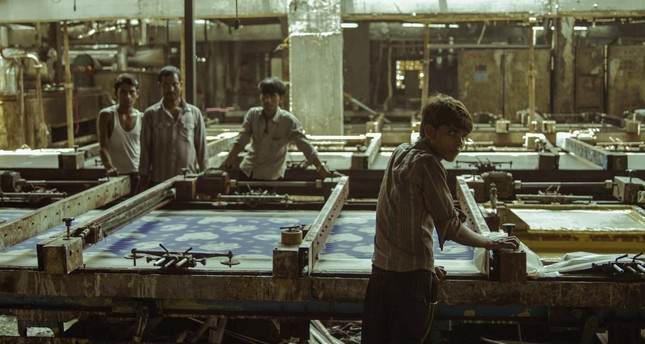 """""""Machines"""" portrays the heavy working conditions at the textile factories in the Indian state of Gujarat."""